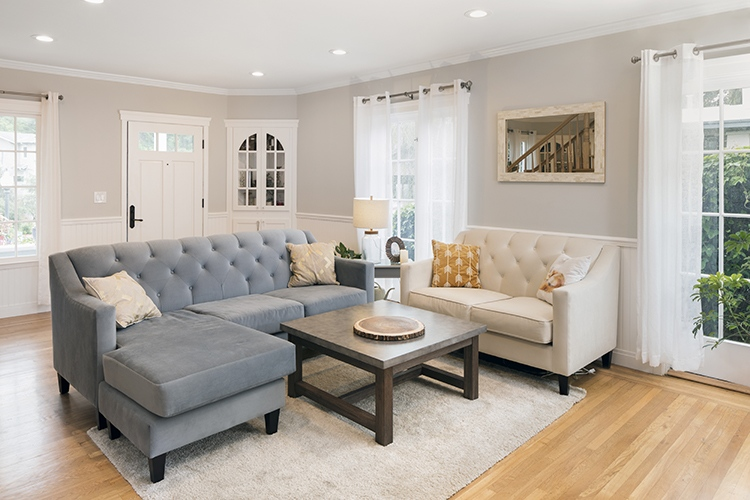 Beautiful and living room interior with hardwood floors and vaulted ceiling in new luxury home.