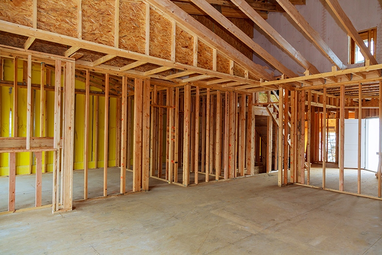 New residential construction home framing against a wooden construction