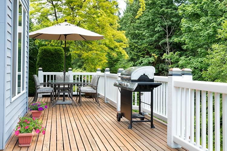 Clean outdoor cedar wooden deck and patio of home during daytime